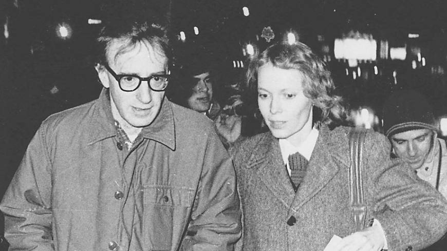Happier times: Woody Allen and actress Mia Farrow stroll up New York's 8th Avenue in January 1984.