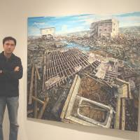 Amer Kobaslija with his painting titled 'Nainowaki Residential Area, May 7, II' (2012). | EDWARD M. GOMEZ