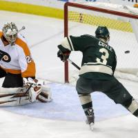 Point blank: Minnesota's Charlie Coyle scores past Philadelphia's Ray Emery in the third period on Monday night. | AP