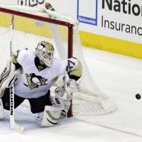 No room at the inn: The Penguins' Jeff Zatkoff saves a shot by the Blue Jackets' Mark Letestu on Sunday. | AP