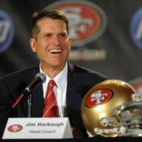 Looking ahead: Coach Jim Harbaugh, who took the San Francisco 49ers to the Super Bowl last season, says he wants to remain with the team for the long haul. | AP