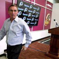 Over and out: Mike Shanahan departs after a news conference on Monday following his firing by the Washington Redskins. | AP