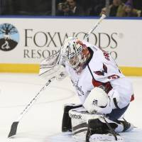 Stop right there: Capitals goalie Philipp Grubauer saves a shot during the second period on Sunday. | AP