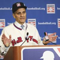 Career capper: Former manager Joe Torre speaks at a news conference on Monday in Lake Buena Vista, Florida, after being elected to the Baseball Hall of Fame. | AP
