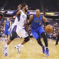 Doing it on both ends: Sacramento's Derrick Williams defends against Dallas' Shawn Marion in the first half on Monday night. The Kings downed the Mavericks 112-97. | AP