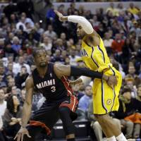 Hook and go: Miami's Dwyane Wade drives around Indiana's C.J. Watson in the first half on Tuesday night. The Pacers 90-84. | AP