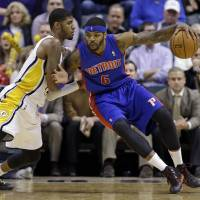 Getting physical: Indiana's Paul George defends against Detroit's Josh Smith in the second half on Monday night. The Pistons ran past the Pacers 101-96. | AP