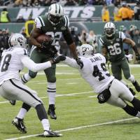 Time to ponder: New York Jets safety Ed Reed, seen here making an interception against Oakland this season, is unsure if he will play a 13th season in the NFL. | AP