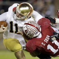 Collared: Stanford linebacker Shayne Skov sacks Notre Dame QB Tommy Rees in the second half on Saturday night. The Cardinal beat the Fighting Irish 27-20. | 'AP