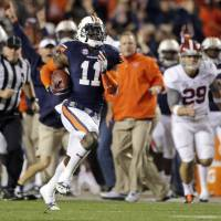Crazy play: Auburn's Chris Davis returns a missed field goal 100 yards for a touchdown against top-ranked Alabama on the final play of the game. The Tigers beat the Crimson Tide 34-28. | AP