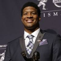 Landslide victory: Florida State freshman QB Jameis Winston poses with his prize after winning the Heisman Trophy on Saturday in New York. Winston is the youngest ever to get the honor. | AP