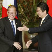 Regional rounds: Prime Minister Shinzo Abe shares smiles with Philippine President Benigno Aquino III ahead of their bilateral talks Friday in Tokyo. The government is hosting an ASEAN leaders' meeting Saturday.  | KYODO