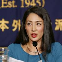 There she was: Miss International 2012 Ikumi Yoshimatsu speaks during a news conference at the Foreign Correspondents' Club of Japan in Tokyo on Monday. | AP