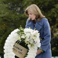 Inaugural visit: U.S. Ambassador Caroline Kennedy places a wreath in front of Peace Statue in Nagasaki's Peace Memorial Park on Friday. | KYODO