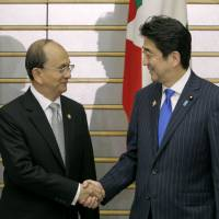 Shake on it: Prime Minister Shinzo Abe and Myanmar President Thein Sein shake hands at Abe's official residence in Tokyo on Sunday. | POOL