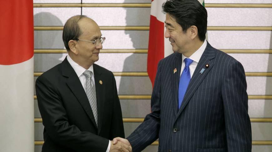 Shake on it: Prime Minister Shinzo Abe and Myanmar President Thein Sein shake hands at Abe's official residence in Tokyo on Sunday.