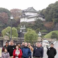 From the outside: Tourists visit the grounds of the Imperial Palace in Tokyo on Nov. 30, 2009. | BLOOMBERG