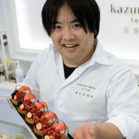 Mouth-watering: Pastry chef Kazunori Ikeda, who runs a sweets store in Sendai selling products using strawberries, shows off some tarts made with locally grown fruit. | KYODO