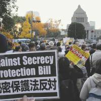 Too little, too late?: Protesters rally against the state secrets bill outside the Diet building Friday. | SATOKO KAWASAKI