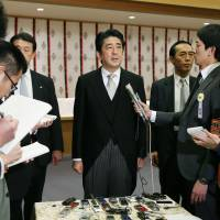 Aftermath: Prime Minister Shinzo Abe talks to reporters after going to Yasukuni Shrine in Tokyo on Thursday. | POOL