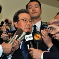 Eye of the storm: Chinese Ambassador Cheng Yonghua is surrounded by reporters after meeting with Vice Foreign Minister Akitaka Saiki to protest Prime Minister Shinzo Abe's visit to Yasukuni Shrine on Thursday. | AFP-JIJI
