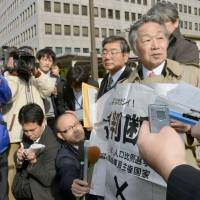 Outcome predictable: Plaintiffs face reporters outside the Takamatsu High Court in Kagawa Prefecture on Monday. | KYODO