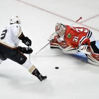 Quack attack: Ducks center Nick Bonino scores past Blackhawks goalie Antti Raanta during the shootout on Friday in  Chicago.  | AP