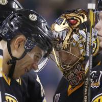 Meeting of the minds: Bruins winger Jarome Iginla (left) shares a moment with goalie Tuukka Rask during Friday's game against the Senators. | AP