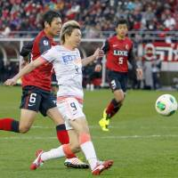 Down to the wire: Hiroshima took care of business on Saturday to win their second consecutive J. league title. | KYODO
