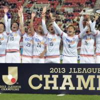 Still the best: Sanfrecce Hiroshima players celebrate their second J.League title in as many seasons on Saturday. | KYODO