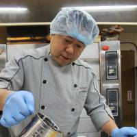 Piece of cake: Hiromichi Iino, president of Baigetsudo, concocts a dessert that looks like a bowl of ramen in the kitchen in the back of his shop. | MASAAKI KAMEDA