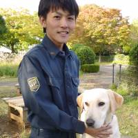 Training drug-sniffing dogs Narita customs officer's window on world