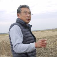 Barren future: Koichi Yuge, who grows rice in Abiko, Chiba Prefecture, says altering the state's price-fixing policy could force him to abandon his family's 300-year-old business. | TOMOKO OTAKE