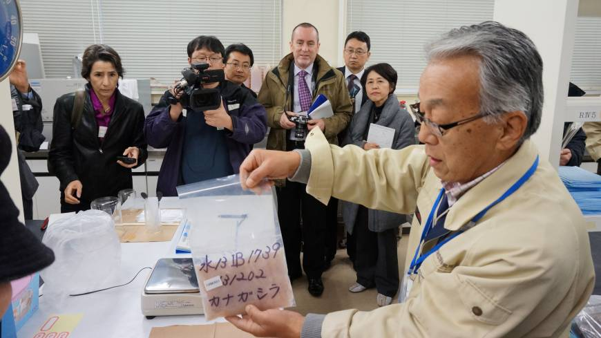 Beyond the Geiger counter: A researcher at Marine Ecology Research Institute in Onjuku, Chiba Prefecture, explains to foreign journalists how a fish sample is prepared for a radiation test.