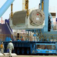 Safe forever?: A metal cask with vitrified high-level radioactive waste is unloaded from a ship at Mutsu Ogawara port in Rokkasho, Aomori Prefecture, in September 2011. | KYODO