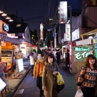 A street in Shin-Okubo is dotted with Korean restaurants and shops popular among fans of South Korean pop culture. | WASHINGTON POST