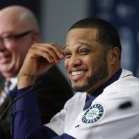 Million-dollar smile: New Seattle Mariners second baseman Robinson Cano smiles during his introductory news conference on Thursday. | AP