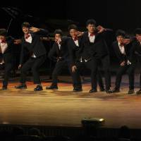 'Brothers' in arms: North Korean defectors reared by Kim Tae-hoon perform during their concert 'With Friend' at Mapo Art Center in Seoul on Nov. 9. | AP
