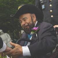 Hispanic hero: Rodolfo 'Rudy' Hernandez is greeted by friends at an event commemorating the 60th anniversary of the end of the Korean War in Washington in July. | THE WASHINGTON POST