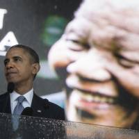 Long time coming: U.S. President Barack Obama speaks at a memorial service for former South African President and anti-apartheid hero Nelson Mandela in Johannesburg on Tuesday. | AFP-JIJI