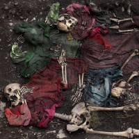 Killing field: Five scattered skeletons unearthed during an exhumation of a mass grave are seen Nov. 13 in Chungui, Peru, where the worst of the nation's 1980-2000 internal conflict occurred. | AP