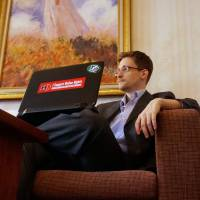 'Indoor cat': Edward Snowden is seen in a hotel room in Moscow earlier this month. | THE WASHINGTON POST