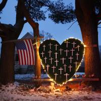 First anniversary: A memorial for the victims of the Sandy Hook massacre stands outside a home in Newtown, Connecticut, on Dec. 14.   AP