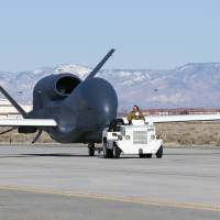 Next-generation simulator: This photo released May 30 by aerospace company Northrop Grumman shows the RQ-4 Block 20 Global Hawk unmanned aircraft that students in the University of North Dakota aviation program will learn to fly. | AP