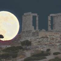 New frontiers: A full moon rises behind the ancient Greek temple of Poseidon at Cape Sounion, 65 km south of Athens, on June 23. | AFP-JIJI