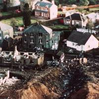 Crash site: Wrecked houses surround a deep gash in the ground in the village of Lockerbie, Scotland, following the crash of Pan Am Flight 103 on Dec. 21, 1988. | AP