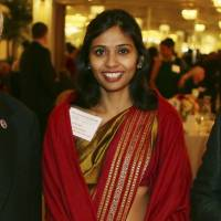 Arrested: Deputy Consul General Devyani Khobragade smiles at Stony Brook University's India studies fundraiser on Long Island, New York, on Dec. 8. | AP