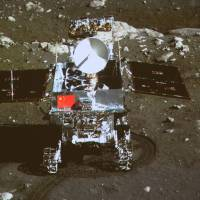 Ready to roll: This image taken by the lunar probe Chang'e-3 shows China's first moon rover, Yutu, in the area known as Sinus Iridum on Sunday. | AP