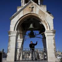 'Like talking to God': Khadir Jaraiseh rings four bells in the tower of Bethlehem's Church of the Nativity on Sunday for prayer services for the Armenian Apostolic Church. | AP