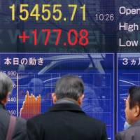 Keeping track: A quotation board in Tokyo displays the Nikkei 225 average in early trading Wednesday. | AFP-JIJI